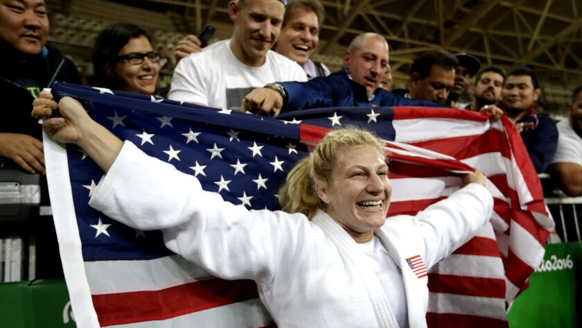 Kayla Harrison celebrates Thursday after repeating as Olympic champion in judo.