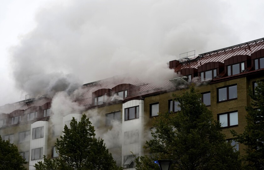 Smoke billows from an apartment building after an explosion in Annedal, central Gothenburg, Sweden, Tuesday Sept. 28, 2021. The explosion took place in the early hours of the morning, and rescue services are still working to extinguish fires that spread to several apartments. (Bjorn Larsson Rosvall/TT via AP)