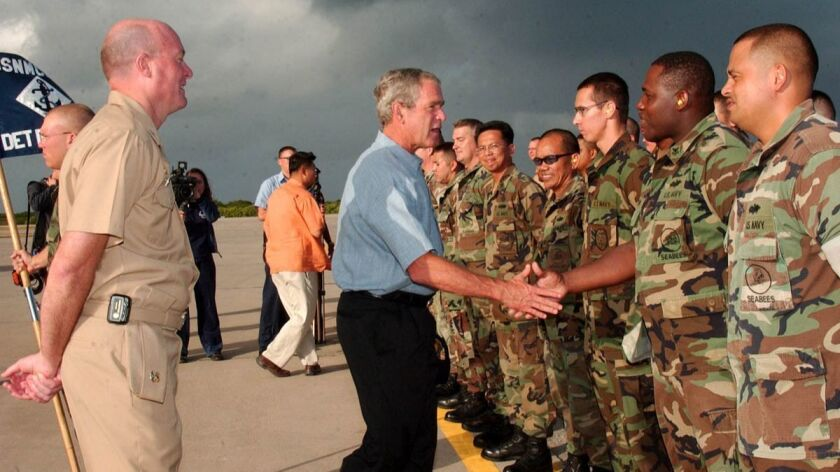 070904-N-1531D-010 DIEGO GARCIA (Sept. 4, 2007) - President George W. Bush meets a group of Seabees