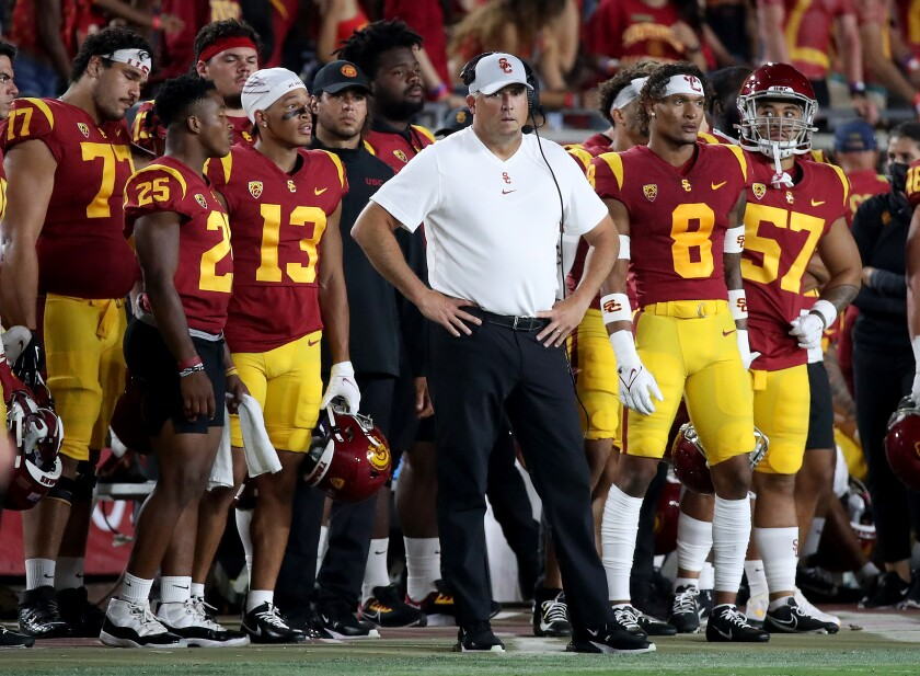 USC coach Clay Helton stands on the sideline at the Coliseum during Saturday's loss to Stanford.