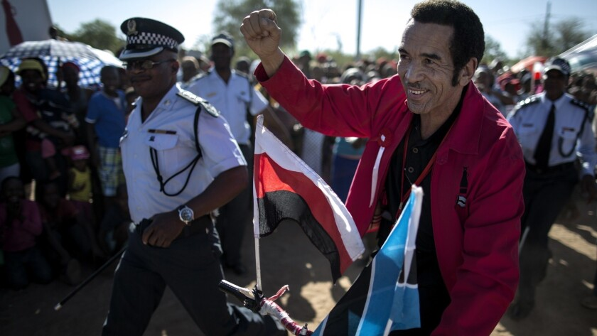 Ian Khama rides a bicycle while campaigning as incumbent for the Botswana presidency in October 2014. On Saturday, he retired after a decade in the post.