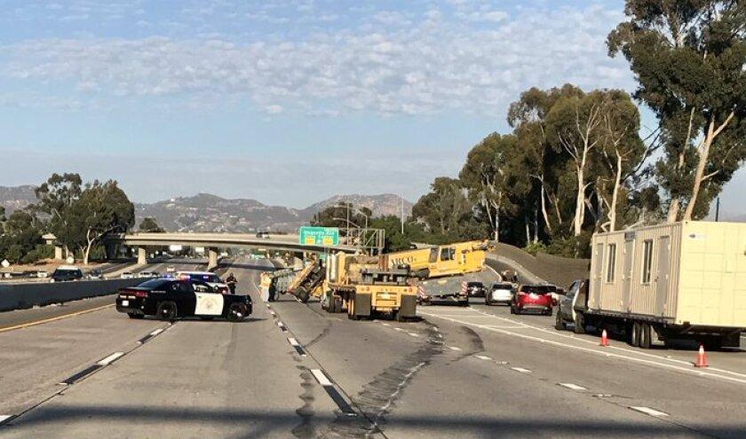 A big rig hauling a crane crashed Monday evening on I-8 east near SR-67 in El Cajon.