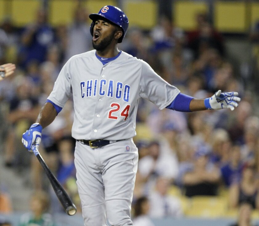 Chicago Cubs' Dexter Fowler reacts to striking out during the fifth inning of a baseball game against the Los Angeles Dodgers in Los Angeles, Saturday, Aug. 29, 2015. (AP Photo/Alex Gallardo)