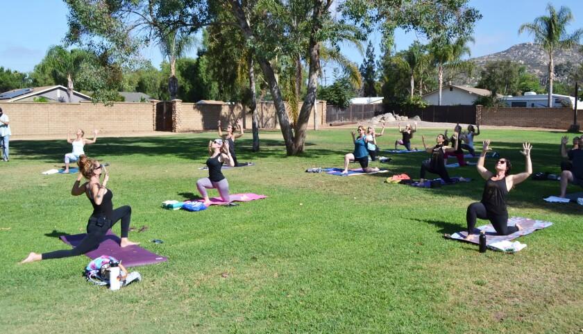 Mello Yoga instructor Torry Chamberlayne leads a yoga class in Aubrey Park.