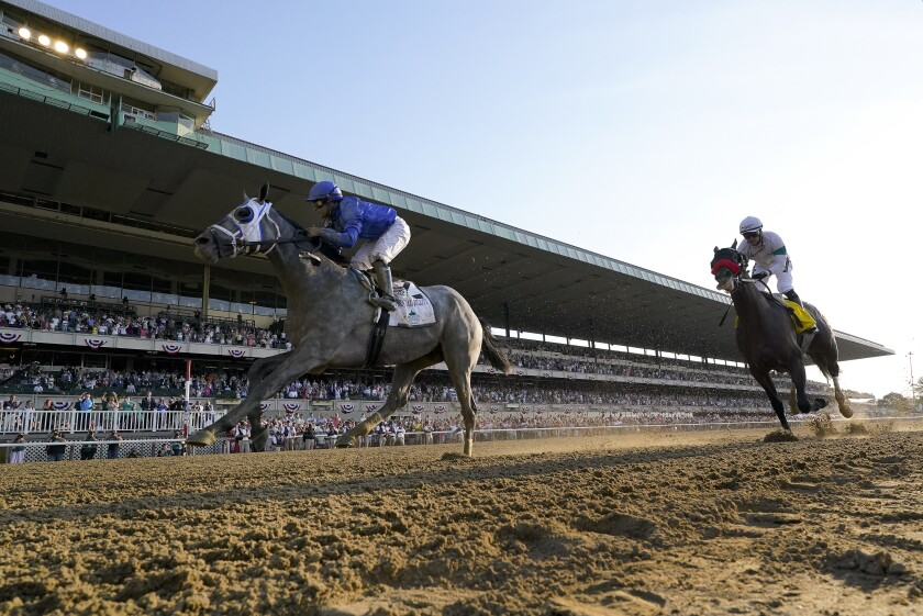 Essential Quality (2), with jockey Luis Saez up, crosses the finish line ahead of Hot Rod Charlie (4), with jockey Flavien Prat up, to win the 153rd running of the Belmont Stakes horse race, Saturday, June 5, 2021, At Belmont Park in Elmont, N.Y. (AP Photo/Seth Wenig)