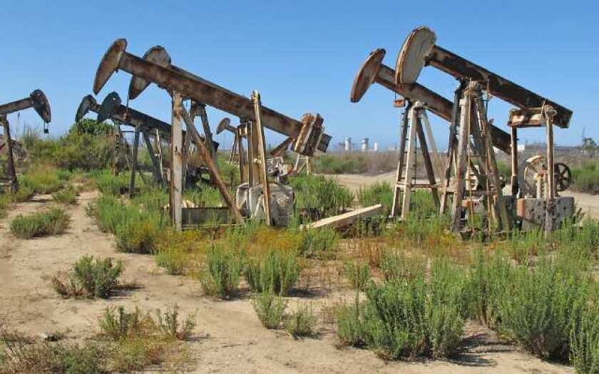 By the sea: West Newport Oil Co. oil pumps occupy portions of Banning Ranch, the large property from West Coast Highway to 19th Street that was recently approved by the Newport Beach City Council for development of homes and other uses.