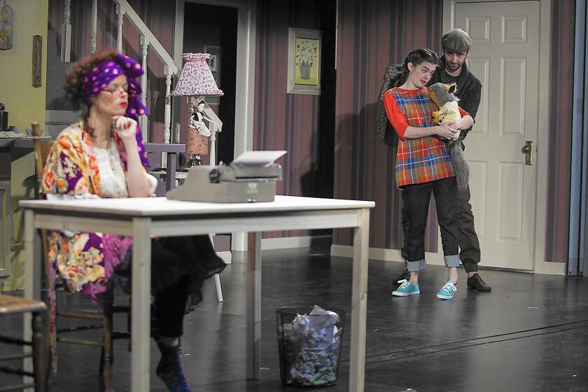 """Ann Noble as Phyllis Buckman, left, Emily Jones as Flora and Alex Suha, the puppeteer controlling Ulysses, rehearse on Feb. 1 for South Coast Repertory's production of """"Flora & Ulysses."""""""