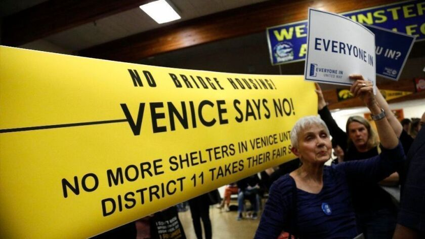 Residents for and against a planned emergency shelter for homeless people in Venice attend an open house on the topic at Westminster Elementary School on June 13, 2018.