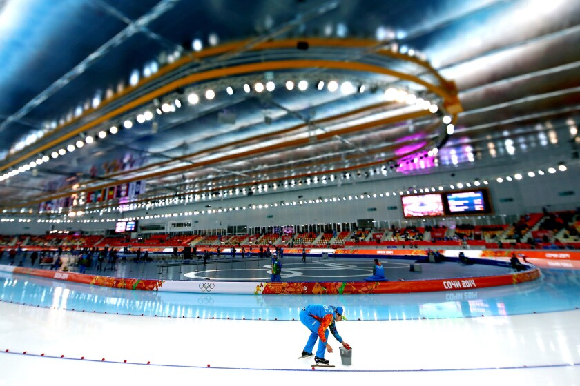 The ice is prepared during the women's 3,000-meter speedskating event during Day 2 of the Sochi 2014 Winter Olympics at Adler Arena Skating Center on Feb. 9, 2014, in Sochi, Russia. Speedskaters prefer a hard, fast surface.