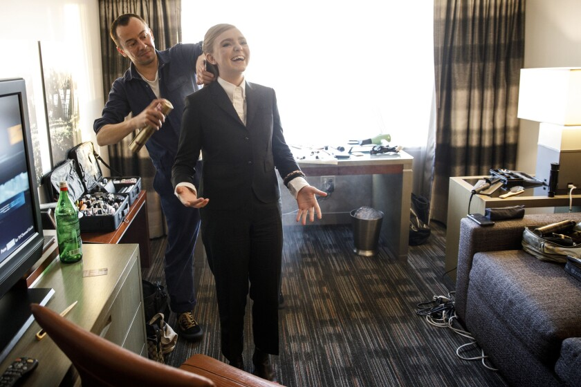 Actress Elsie Fisher, 15, dances while having her hair sprayed before the Academy of Motion Picture