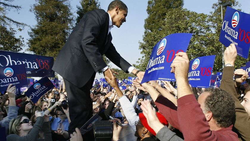 Then-presidential candidate Barack Obama greets supporters during a rally at Rancho Cienega Recreation Center in Los Angeles on Feb. 20, 2007.