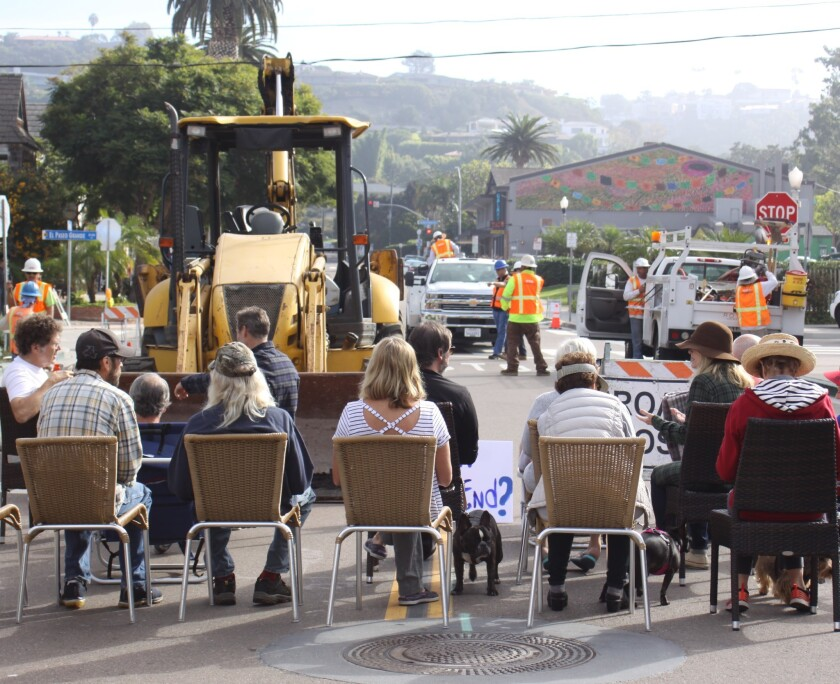 Concerned citizens gather as construction takes place on Avenida de la Playa, The Shores' main thoroughfare.
