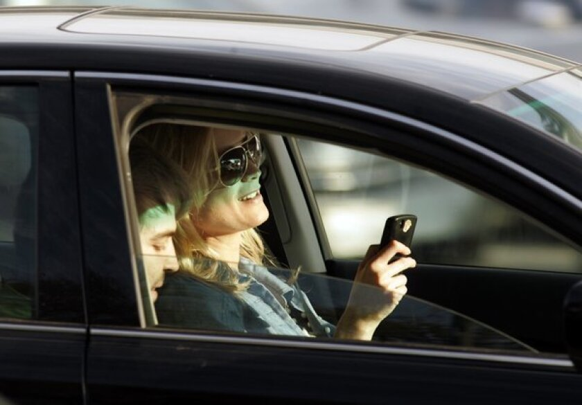 Poll: Cellphone-driving bans not working; state ramps up anyway