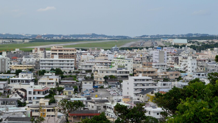Marine Corps Air Station Futenma, which sits in the middle of a dense urban area, is slated to be closed and its functions relocated elsewhere on Okinawa. But opposition to the new facility has stalled the move.