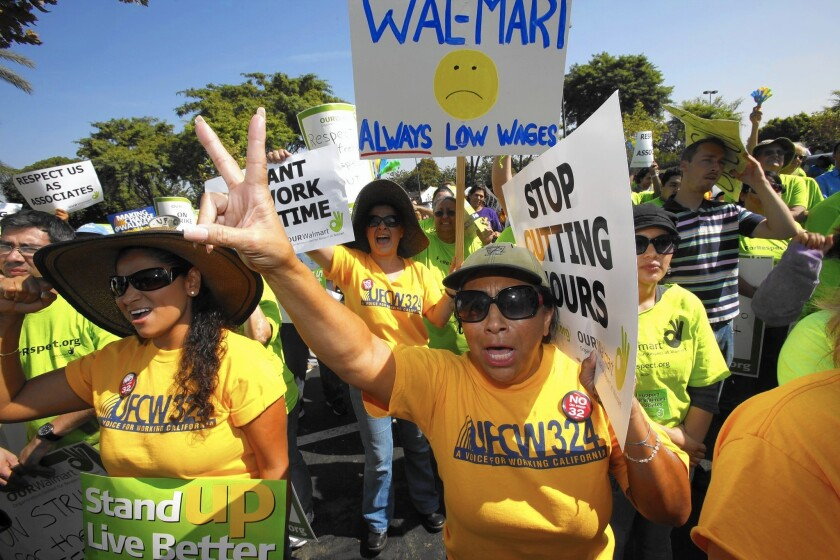 Several hundred Wal-Mart workers stage a walkout and protest in front of the Pico Rivera store in 2012.