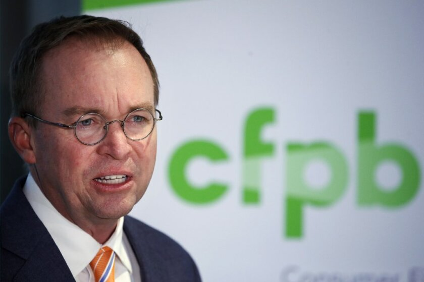 FILE - In this Nov. 27, 2017, file photo, Mick Mulvaney speaks during a news conference after his first day as acting director of the Consumer Financial Protection Bureau in Washington.