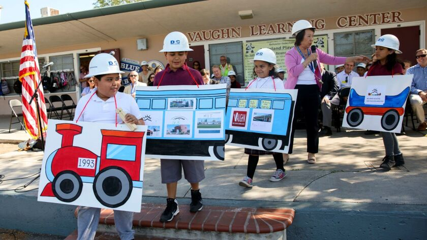 Yvonne Chan, longtime leader of the Vaughn charter complex, guides students through a dramatization of a new construction project.