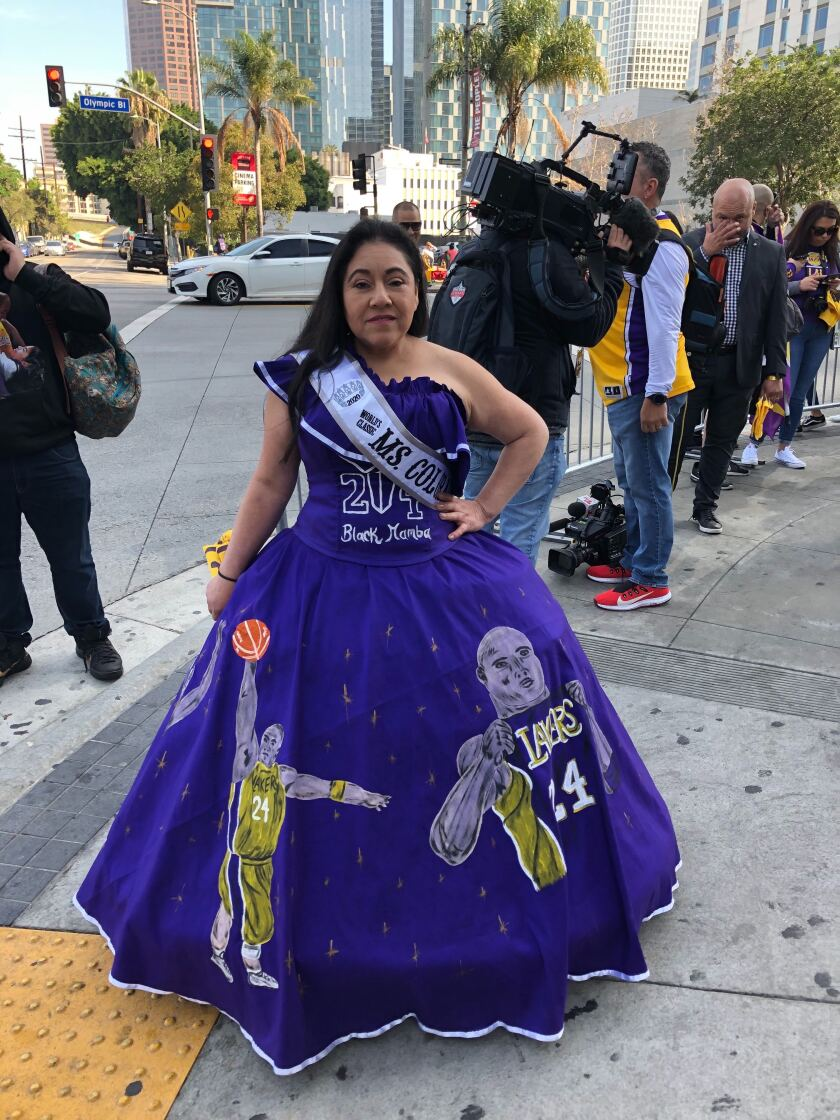 Franchesca Flores, 43, of Littleton Colorado arrived outside Staples Center in a hand-painted purple ball gown with images of Kobe and Gianna Bryant shooting hoops.