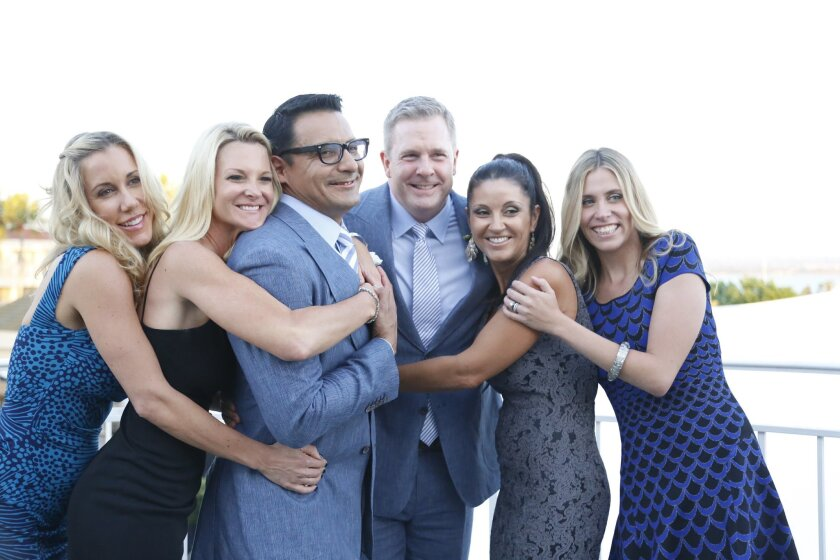 At their wedding in a  Coronado park in August, Oscar de Las Salas and Gary Jackson were heckled. Now a group of Coronado residents and businesses have banded together to for a do-over at the Coronado Loews.  Oscar de Las Salas and Gary Jackson with their organizers of the do-over wedding From le