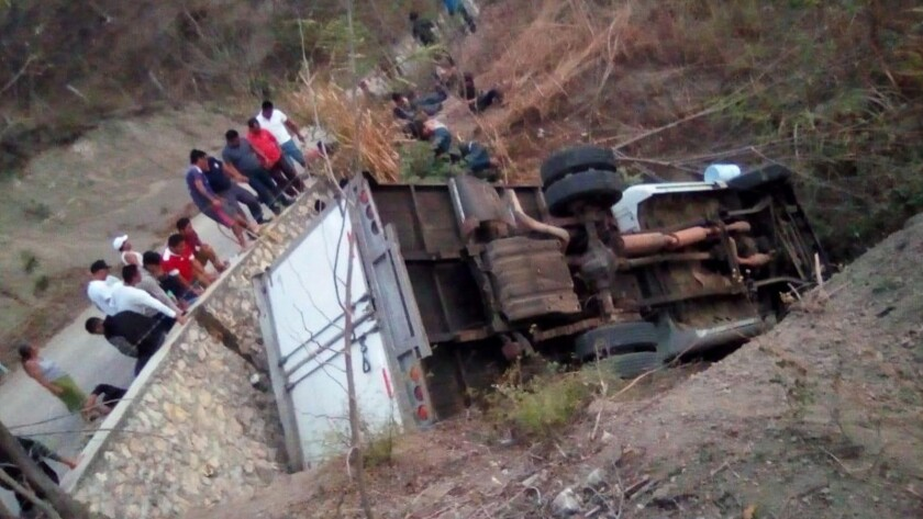 A truck that carried Central American migrants lies overturned off the Ixtapa-Soyalo highway in the state of Chiapas, Mexico.