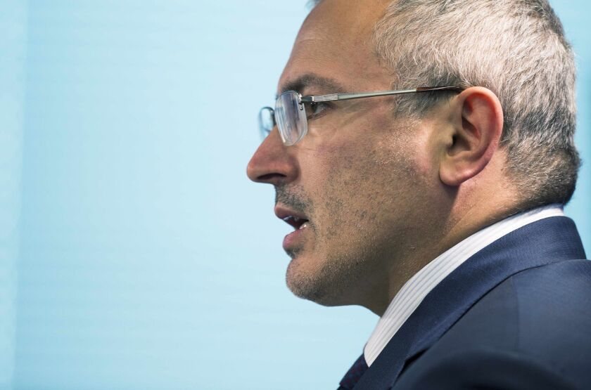 Kremlin critic and former oil tycoon Mikhail Khodorkovsky, seen here speaking to the Atlantic Council in Washington on June 17, has been named by the Russian Investigative Committee as a possible suspect in a 1998 killing.