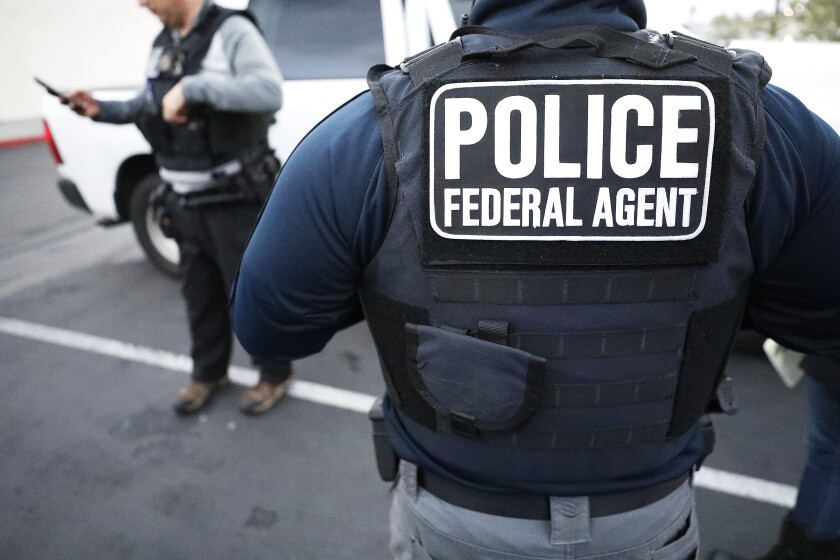 Two U.S. Immigration and Customs Enforcement officers.