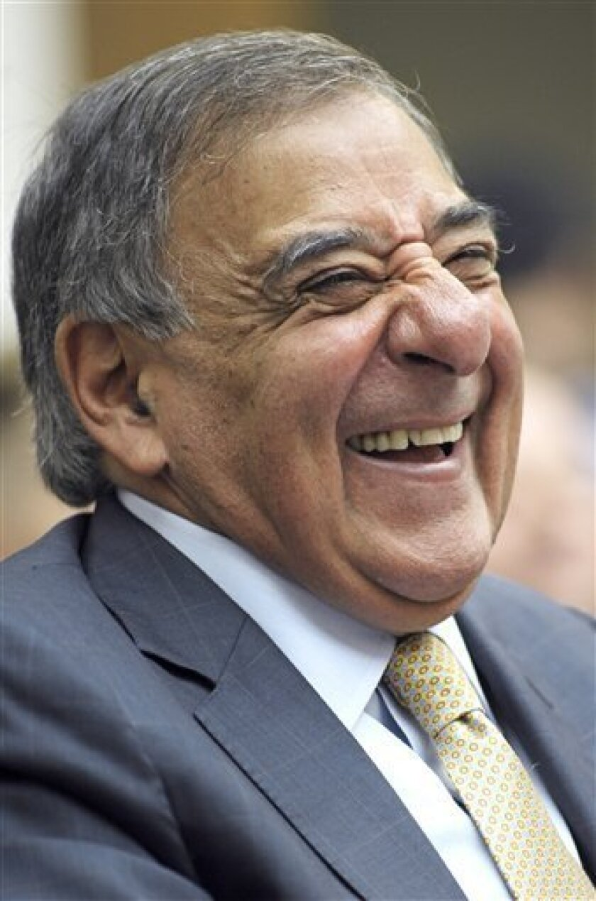 Defense Secretary Leon Panetta laughs as he testifies on Capitol Hill in Washington, Thursday, Oct. 13, 2011, before the House Armed Service Committee hearing on defense ten years following the 911 attacks. (AP Photo/Cliff Owen)