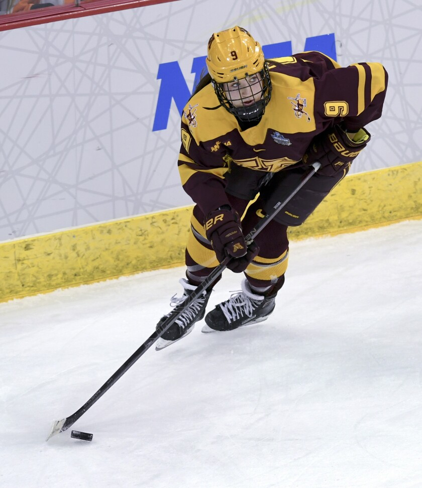 """FILE - In this Sunday, March 24, 2019 file photo, Minnesota's Taylor Heise (9) controls the puck during the third period in the NCAA Division I women's Frozen Four hockey championship game against Wisconsin in Hamden, Conn. A viable professional hockey league for women is the goal of the current crop of veteran players, and the youngsters who dream of playing the sport professionally when they get older are behind the current efforts being made. Sophomore Taylor Heise of the University of Minnesota, says having them fight for players like her """"is amazing."""" (AP Photo/Stephen Dunn, File)"""