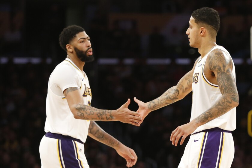 Kyle Kuzma and Anthony Davis high-five during the second half of a game against the Timberwolves on Dec. 8 at Staples Center.