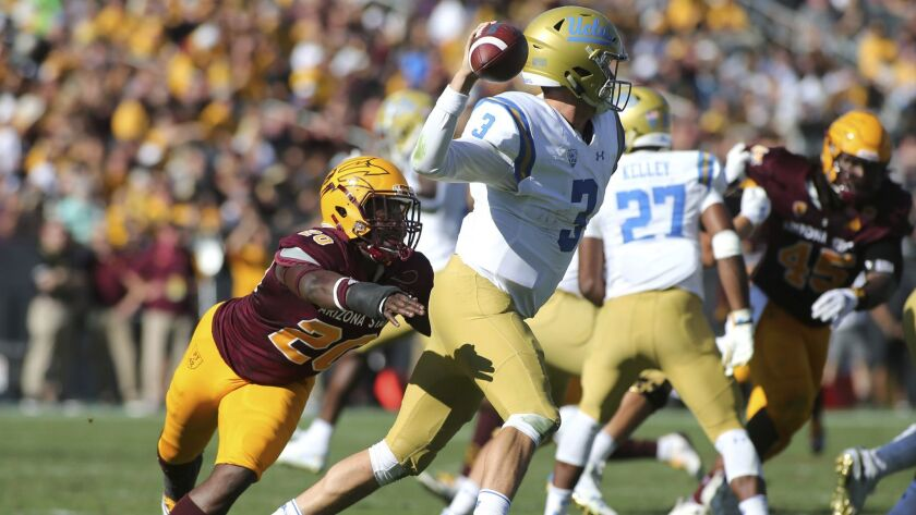 UCLA's Wilton Speight tries to pass under pressure by Arizona State linebacker Khaylan Kearse-Thomas in the second half.