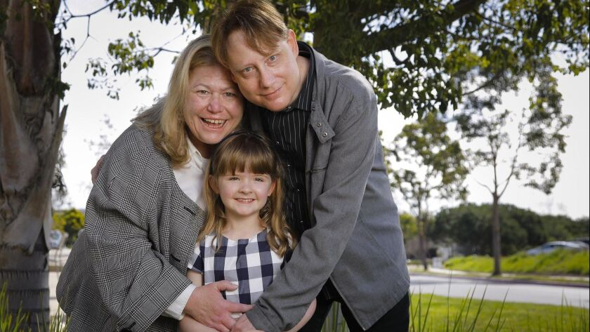 Amanda Walker, 8 3/4 years old, has a rare genetic disease called MHE that causes abnormal bone growth. She's with her parents, Alicia Walker, left, and her dad, Robert Walker.