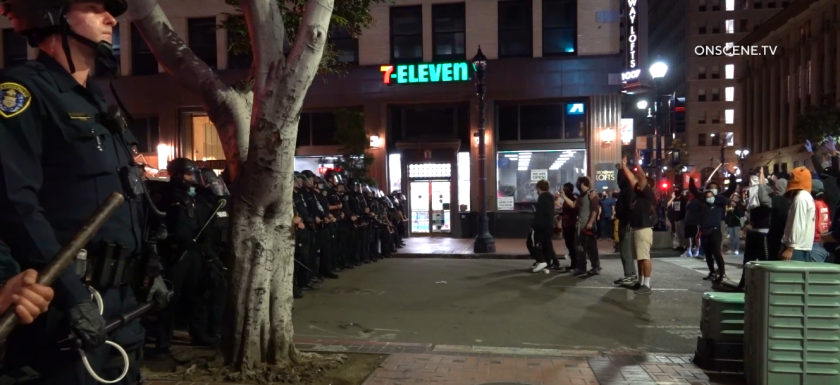 Police faced off with a crowd of protesters in downtown San Diego late Sunday evening. Officers made more than 90 arrests late Sunday and early Monday.