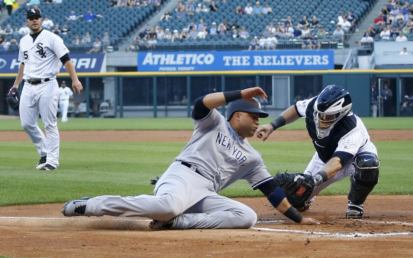 New York Yankees right fielder Carlos Beltran, center, is tagged out at home by Chicago White Sox catcher Alex Avila, right, as White Sox starting pitcher Carlos Rodon, left, looks on during the first inning of a baseball game in Chicago, on Tuesday, July 5, 2016. (AP Photo/Jeff Haynes)