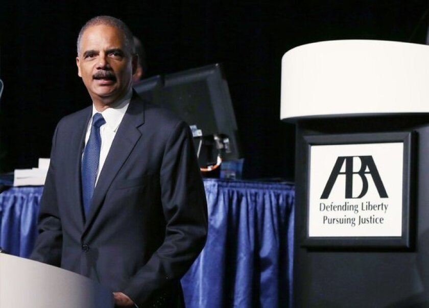 U.S. Atty. Gen. Eric Holder, seen here speaking during the 2013 America Bar Assn. annual meeting on Tuesday, announced major changes in the sentencing of certain drug-related crimes in an effort to reduce overcrowding in the nation's prisons.