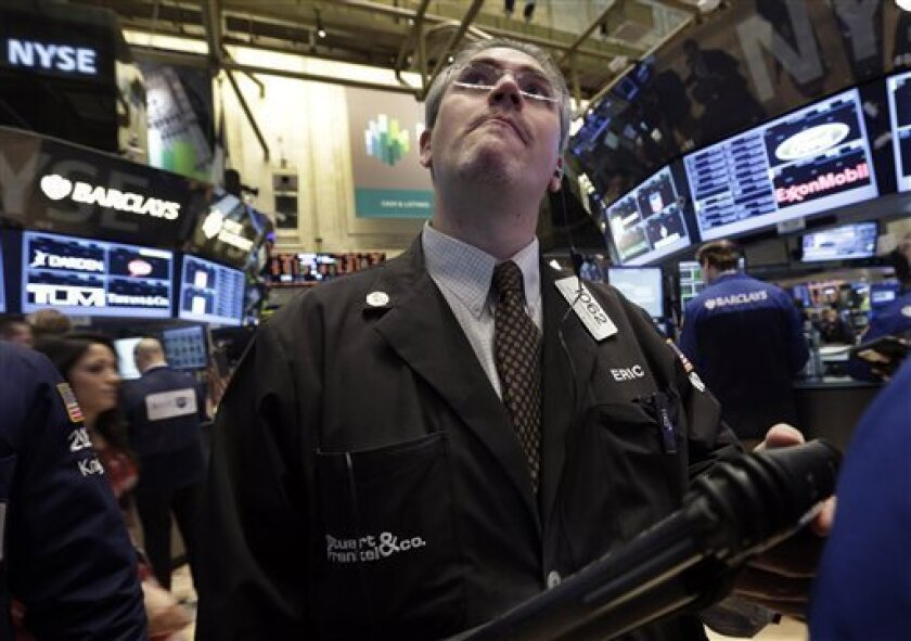 FILE - In this Tuesday, Feb. 5, 2013 file photo, trader Eric Schumacher works on the floor of the New York Stock Exchange, in New York. Tokyo's Nikkei 225 led Asian stocks higher Tuesday, Feb. 12, 2013, and investors appeared to have shrugged off an apparent nuclear test by North Korea. In the Unit