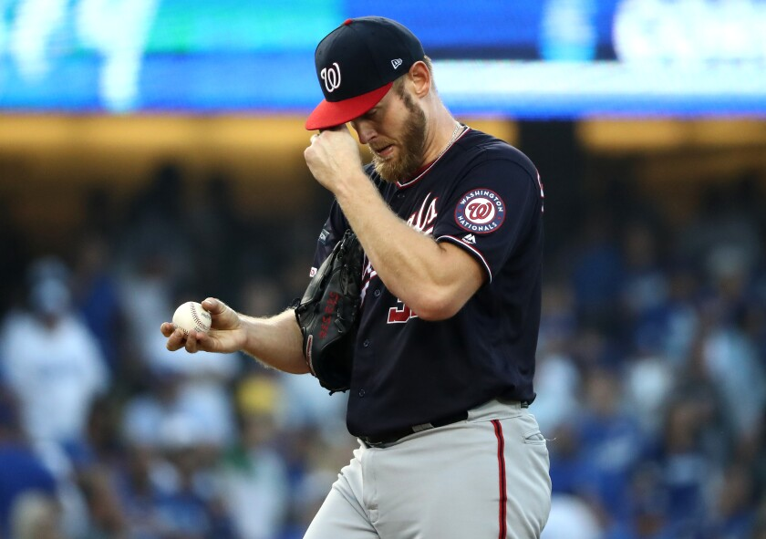 Former San Diego State star Stephen Strasburg labors through a two-run first inning Wednesday against the Dodgers in Game 5 of the N.L. Division Series at Dodger Stadium.