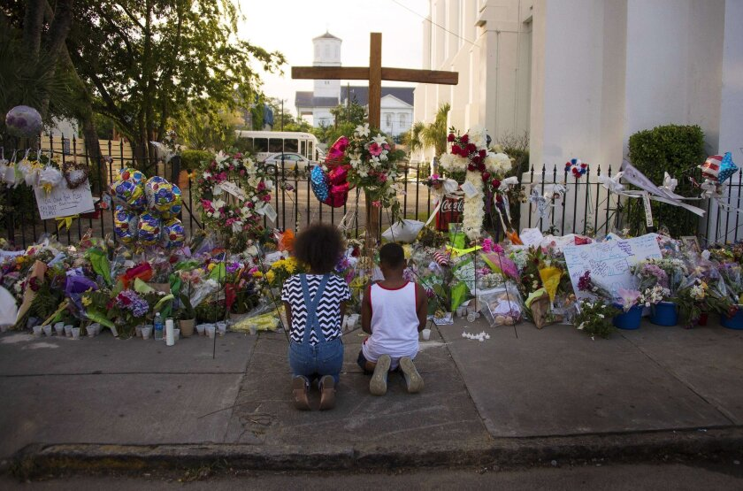 Two children pray outside Emanuel AME Church in Charleston, S.C. where nine churchgoers were shot dead during bible study on June 17.