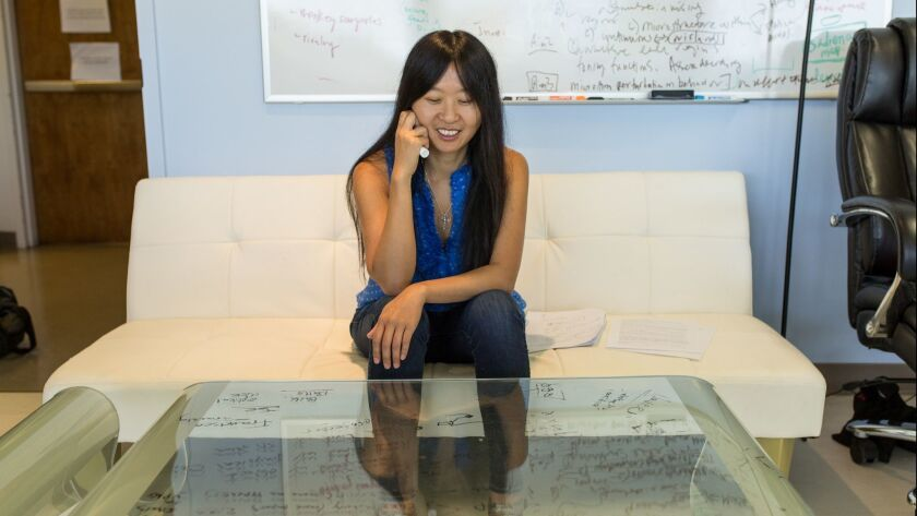 Neuroscientist Doris Tsao, shown in her Caltech office, is working to uncover the fundamental neural principles that underlie the brain's ability to recognize a face.