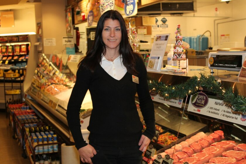 Angie Elsbury poses at the Vons meat department in La Jolla, which she manages.