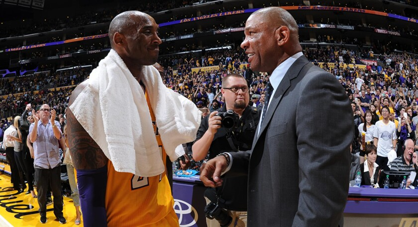 Lakers legend Kobe Bryant and Clippers coach Doc Rivers chat after a game in 2016.
