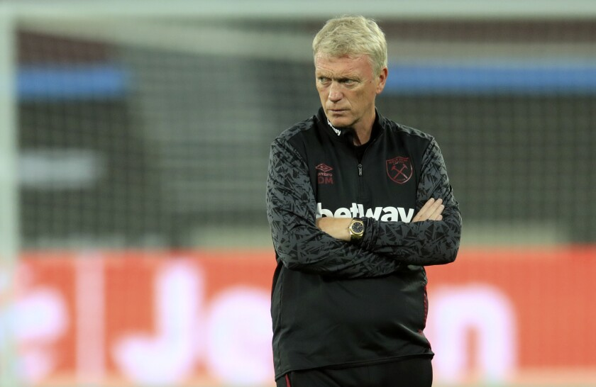 West Ham's manager David Moyes looks on during warmup before the English Premier League soccer match between West Ham United and Newcastle United at the London Stadium in London, Saturday, Sept. 12, 2020. (Adam Davy/Pool via AP)