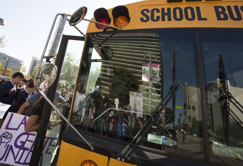 Students board an L.A. bus back to school after a November walkout. The school district disclosed this week that it fired a bus supervisor and pressured two subordinates to resign for alleged drinking and drug use.