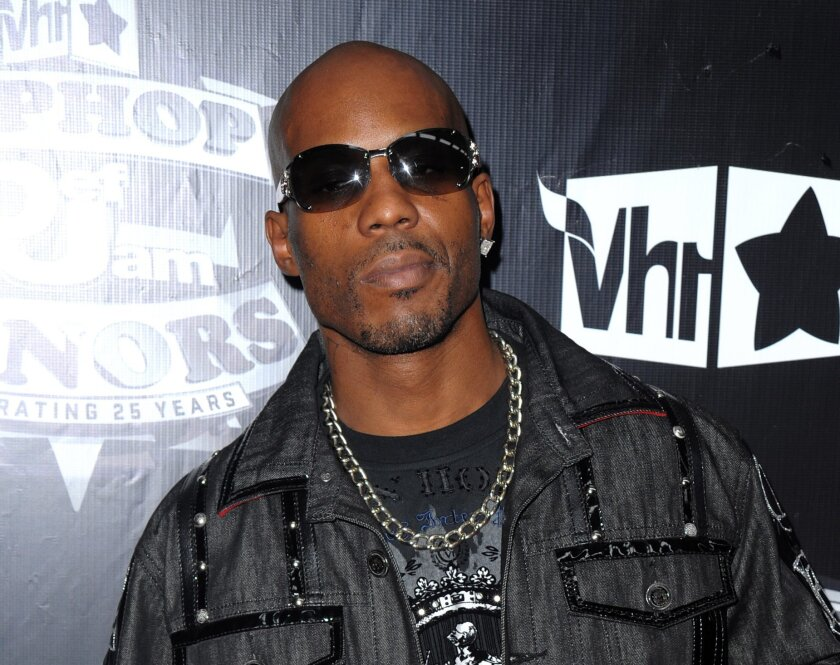 FILE - In this Sept. 23, 2009 photo, DMX arrives at the 2009 VH1 Hip Hop Honors at the Brooklyn Academy of Music, in New York. An attorney for DMX said the rapper has recovered after police officers resuscitated him outside a hotel in Yonkers, N.Y. (AP Photo/Peter Kramer, File)