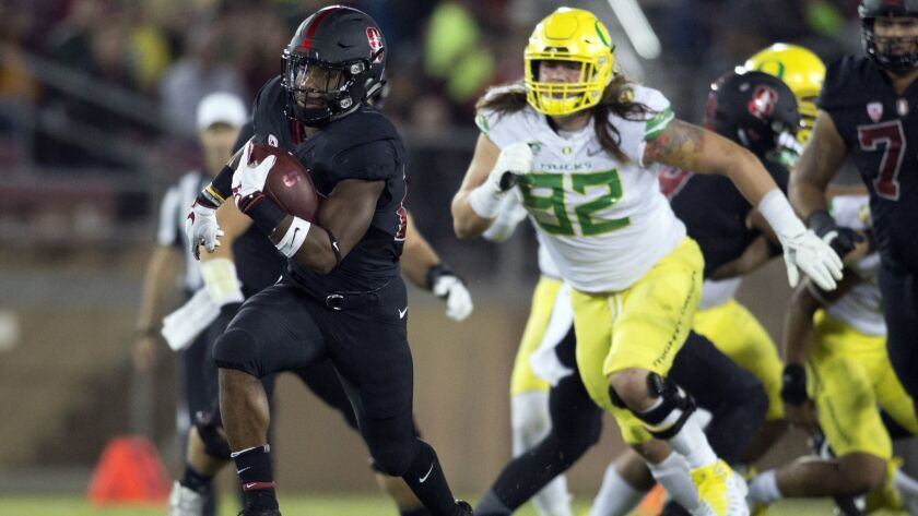 Stanford's Bryce Love (20) breaks free for a long touchdown against Oregon during the first quarter on Oct. 14, 2017 in Stanford. Love and the Cardinal will take on Oregon this Saturday in a top-25 showdown.