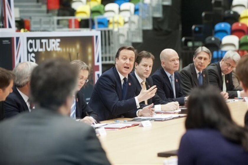 Britain's Prime Minister David Cameron, centre, chairs a meeting of the Cabinet in the Handball arena at the Olympic Park, London Monday Jan. 9, 2012. Britain's Prime Minister David Cameron held a special Cabinet meeting Monday at Olympic Park amid tight security, marking 200 days until the Summer Games and promising that the event will offer a lasting legacy for the nation. (AP Photo/Glenn Copus, Pool)