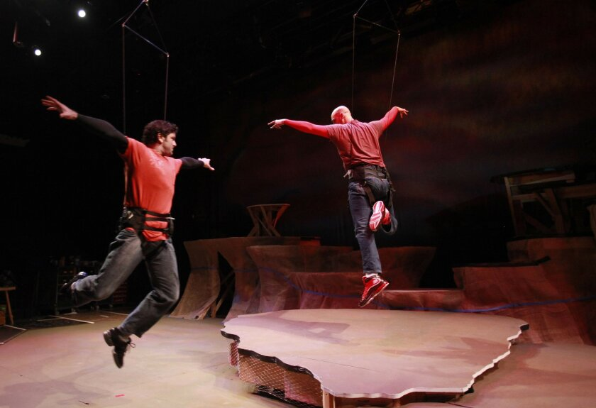 "Patrick J. Duffy (left) and Lance Arthur Smith rehearse an aerial fight scene in Lamb's Players Theatre's ""The Book of the Dun Cow."""