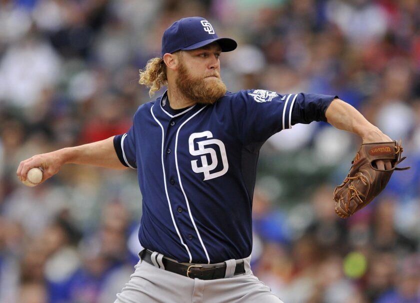 San Diego Padres starter Andrew Cashner delivers a pitch during the first inning of a baseball game against the Chicago Cubs, Sunday, April 19, 2015, in Chicago. (AP Photo/Paul Beaty)