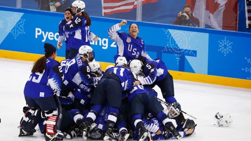 U.S. women's players celebrate beating Canada for gold at the 2018 Winter Olympics in Pyeongchang.