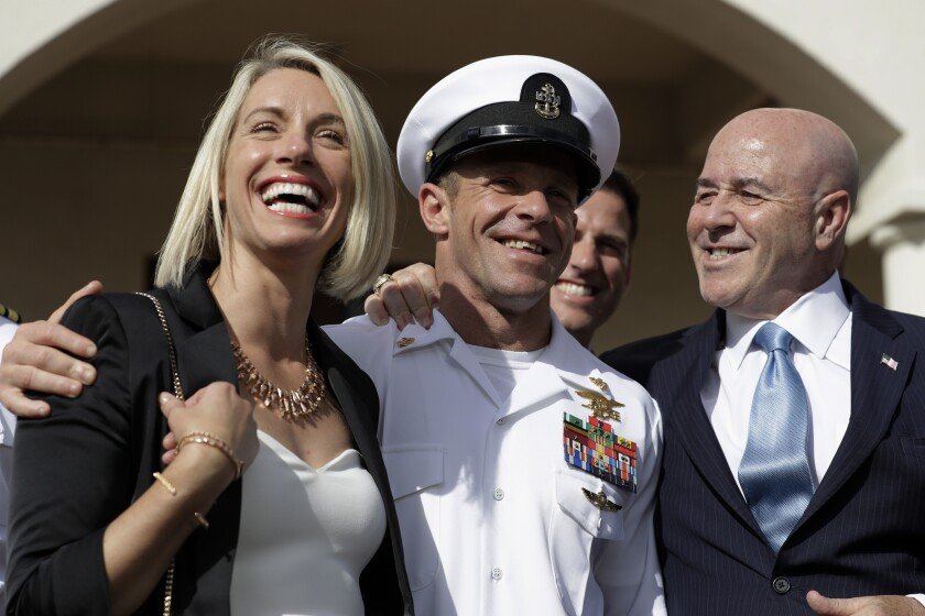 Navy SEAL Petty Officer 1st Class Eddie Gallagher, his wife Andrea Gallagher and legal advisor Bernard Kerik as they leave a military court on Naval Base San Diego, Tuesday, July 2, 2019. in San Diego.