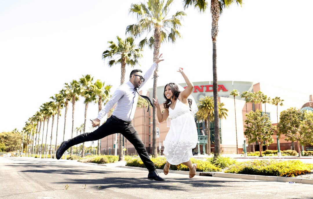 Russel and Kathleen Sion of Torrance, both 29, celebrate their marriage in Anaheim.